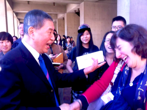 Pai Hsien-yung greets a former student from UCSB after his speech. Many attendees were eager to meet the author. Photograph by Maggie Tsai.
